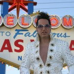 Elvis and Vegas tourists visiting the famous Las Vegas sign